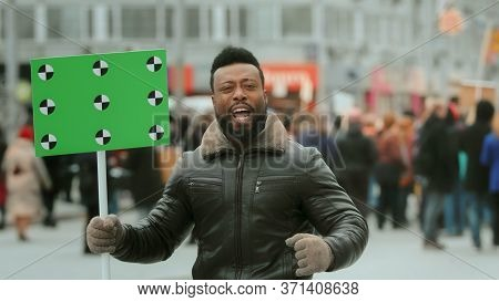 African American Man. Empty Banner. Hand Wave. Track Point. Copyspace. Blank Board Placard. Crowd Pe
