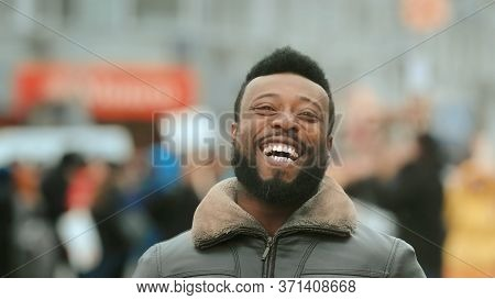 Close-up Young Adult American Black Man In Jacket Smiling And Looking At Camera. Smile Human. Cold W