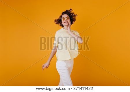 Pale Girl With Ecstatic Face Expression Enjoying Photoshoot In White Summer Attire. Pleased Young Wo