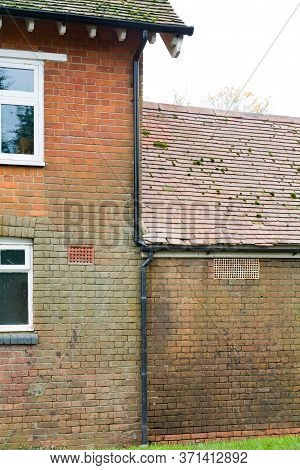Water Damage, Damp And Staining On A Brick Wall Due To Leaking Damaged And Overflowing Gutters And D