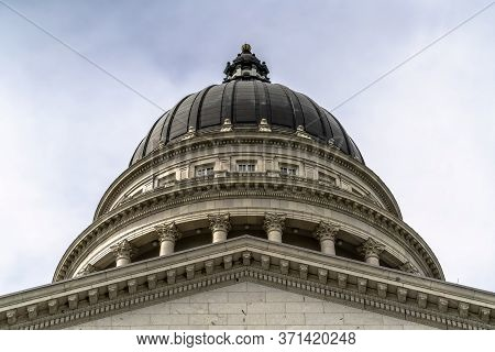 Dome And Pediment Of Utah State Capital Building In Salt Lake City Against Sky