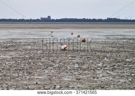 Watt Landscape With Buoys At Low Tide
