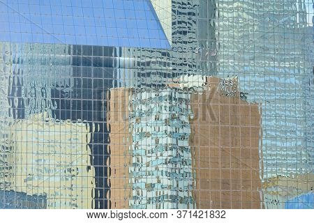 Reflection Of Skyscrapers On Another Skyscraper. Picture Was Taken In Dallas, Tx.