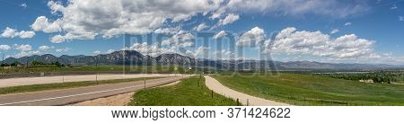 Panoramic View Of Flatirons Mountains In Boulder, Colorado, On A Sunny Day
