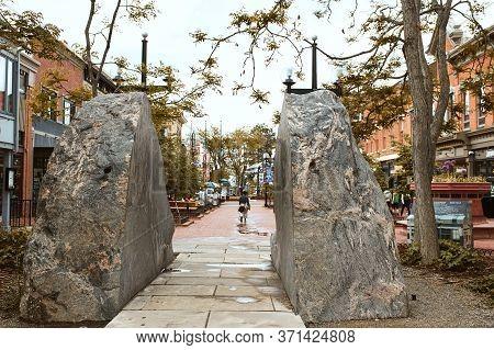 Boulder, Colorado - May 27th, 2020: Park Boulder Rock Feature Along Pearl Street Mall, A Pedestrian