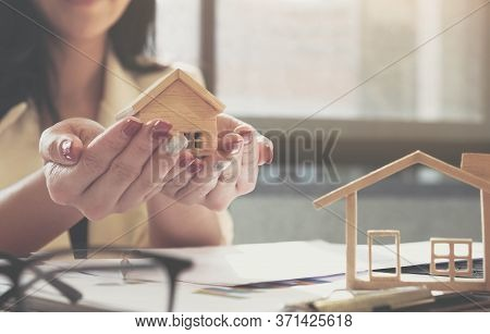 Estate Agent Gives Model House To Agreement With Customer To Sign Contract For . Concept Insurance