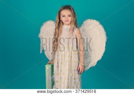 Valentines Day. Saint Valentines Day Card. Child Wearing Long White Dress And Angel Wings. Pretty Li