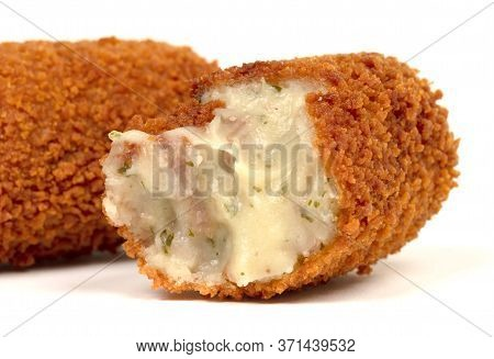 Partly Eaten Brown Crusty Dutch Kroket Isolated On A White Background