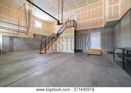 Large Open Plan Concrete Basement Interior Garage