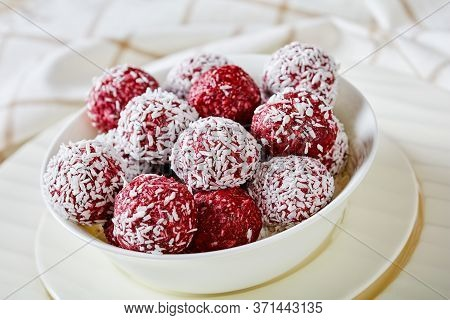 Gluten-free Berry Bliss Balls With Desiccated Coconut And Chia Seeds Raspberries, Blackberries, Blue