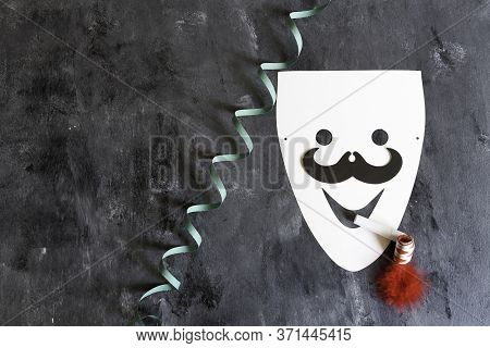 Paperboard Mask With Serpentine And Matasuegras On Dark Background
