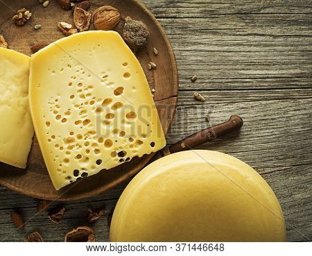 Various Kind Of Hard Cheese Served On Wooden Table, Traditional Pieces Of Hand-made Cheese. Copyspac