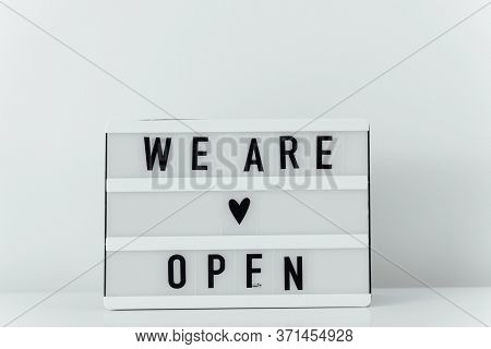 Open Again Sigh On Wooden Table. Local Business Reopen After Quarantine Covid-19
