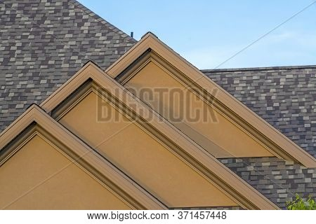 House Exterior With Front Gable Roof Design Against Blue Sky Background