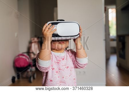 Toddler Girl With Vr Glasses At Home. Learning, Watching Movie, Playing Games. Future Technologies