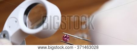 Jeweler Examines Red Gem Under Magnifying Glass. Validation Precious Item. Removal Accumulated Pollu