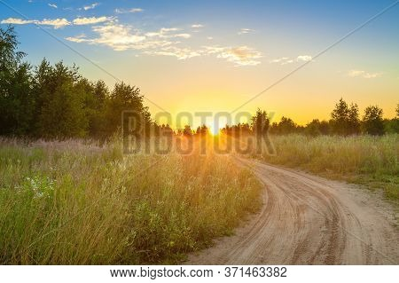 Amazing Summer Rural Landscape With Sunrise, Road And Forest . Scenery Spring Scene View