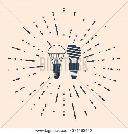 Black Economical Led Illuminated Lightbulb And Fluorescent Light Bulb Icon Isolated On Beige Backgro