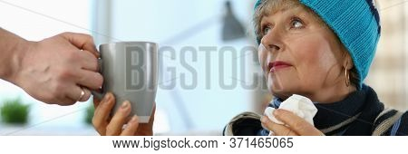 Cold Elderly Lady In Knitted Hat Takes Cup Tea. Side Effects Drugs. Cold Medicine For Elderly. Paren