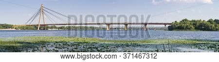 Modern Road Cable-stayed Bridge Over River, Wide Panoramic View. Pivnichnyi (former Moskovskyi) Brid