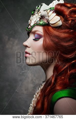 Redhead Girl Fabulous Look, Green Long Dress, Bright Makeup And Big Eyelashes. Mysterious Fairy Woma
