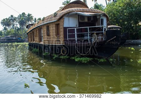 Alappuzha, Kerela, India - January 22, 2020 - Beautiful Boathouse Parked On The Lake In The Bright S