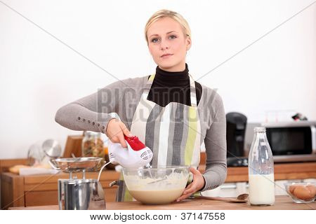 Woman with a blender in the kitchen poster