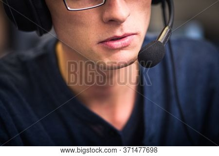 Interpreting - Male interpreter  simultaneous interpreter booth (shallow DOF)