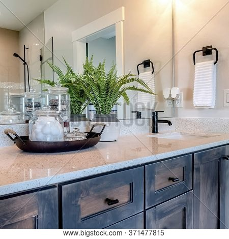 Square Bathroom Vanity With Two Sinks And Mirror That Reflects Shower Stall And Door