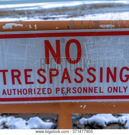 Square Frame Close Up Of No Trespassing Signage With Snowy Utah Lake Background In Winter