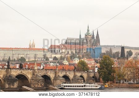 Charles Bridge (karluv Most) And The Prague Castle (prazsky Hrad) Seen From The Vltava River With A