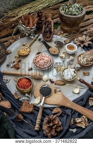 Various Spices And Herbs In Rustic Style With Honey On Balck Background. Natural Herbs Medicine, Org