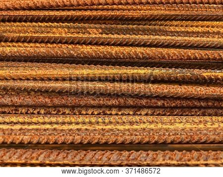 Closeup Of Old Weathered Iron Armature, Metal Wire Reinforcement Background. Steel Construction Back