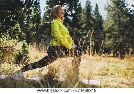 Fun Girl Exercising Outdoors In Green Park Sun Summer Day, Activity With Stretch Legs. Smile Fitness