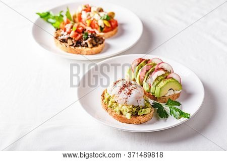 Toast With Avocado And Poached Egg And Toast With Avocado And Radish. Healthy Food Concept.