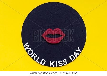 Words World Kiss Day Or International Kissing Day. 6th July. Greeting Card. Red Lips On Yellow Backg