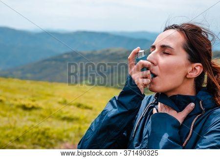 Woman Hiker Taking Asthma Pump Inhalation. Woman Asthma Puffing. Asthma Pump. Woman Hiker With Asthm