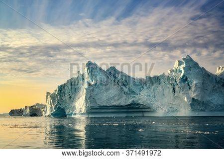 Greenland Ilulissat Glaciers At Ocean At Polar Night With Bird