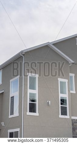 Vertical Crop Townhouses Exterior With Small Balconies At The Facade In South Jordan Utah