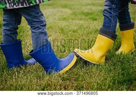 New Way Of Greeting. New Normal. Two People Bump Their Rubber Boots Demonstrating A New Way Of Greet