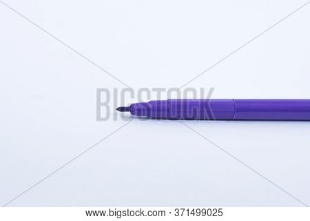 Close-up Violet Felt Tip Marker Pen On White Background. Also Known As Sketch Pen Or Highlighter. Us