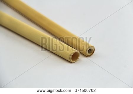 Two Biodegradable Bamboo Straws On A White Background. Environmentally Friendly Alternative To Plast