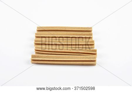 Colorful And Crisp Image Of Chewing Sticks For Dogs On White Background