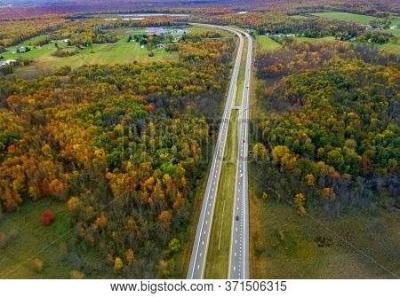 The Aerial View Of The Highway With Stunning Fall Foliage Near Syracuse, New York, U.s.a