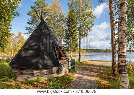 Small, old traditional house from Scandinavia. Wooden shelter hut near the lake at autumn in Finland