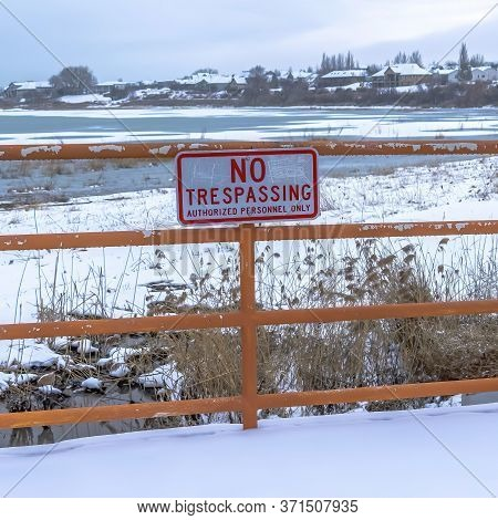 Square Frame Scenic Utah Lake In Winter With No Trespassing Sign A Fence In The Foreground
