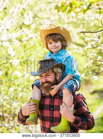 Love My Father So Much. Father And Child In Spring Garden. Father Give Son Piggyback. Bearded Man Fa