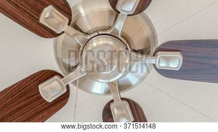 Panorama Ceiling Fan With Wooden Blades And Lights Mounted On The Ceiling Of A Home