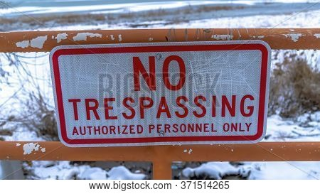 Panorama Frame Close Up Of No Trespassing Signage With Snowy Utah Lake Background In Winter