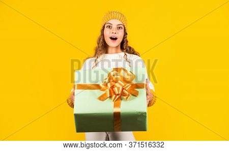 Dear Santa. Surprise. Happy Little Smiling Girl With Christmas Gift Box. Kid Hold Present Box Yellow